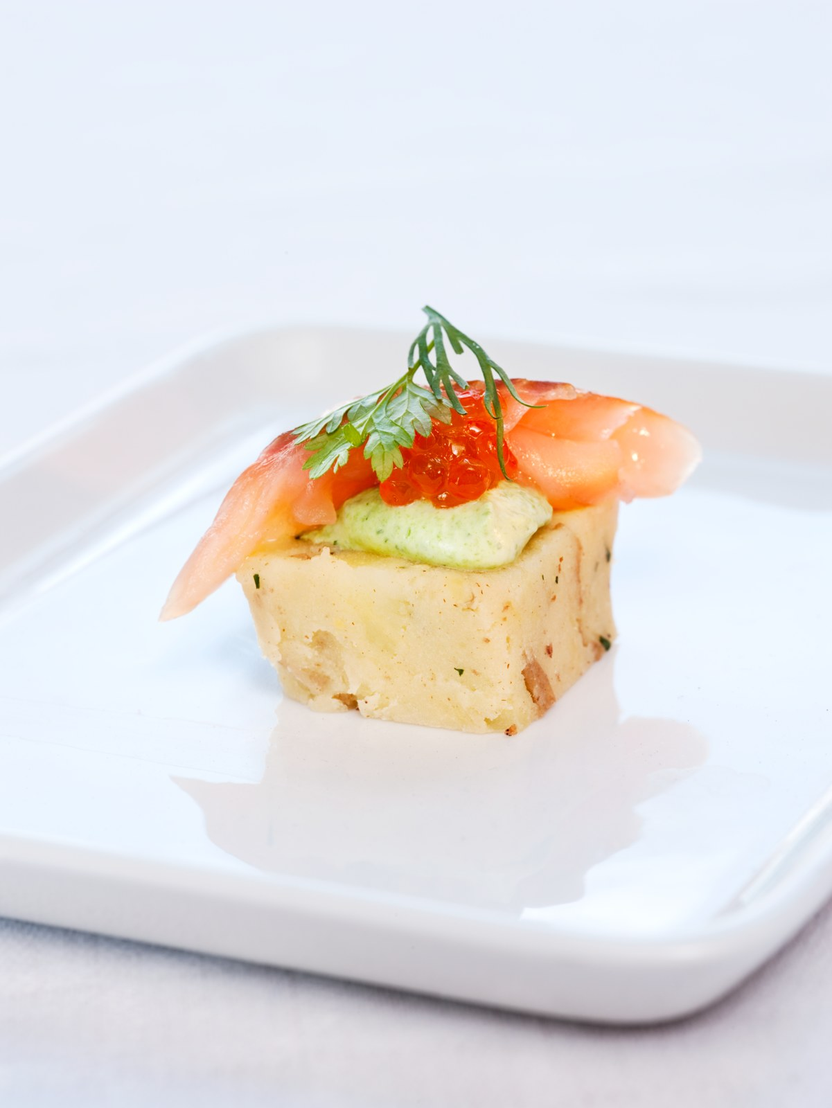 Appetizer of smoked arctic char, honey and mustard terrine, dillcream